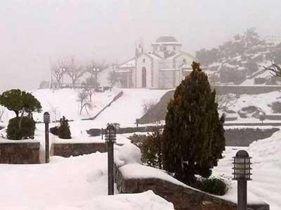 Greek orthodox church during snowy winter moths