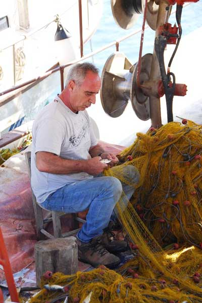 as a cretan fisherman we worked in the back office on the nets